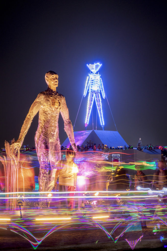 Huge Sculpture of a man next to the Man at Burning Man