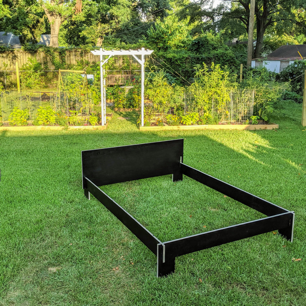 bed frame in the back yard